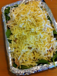Green Turkey and Cheese ready to be put into oven.